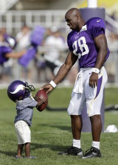 NFL players and their adorable kids at training camp